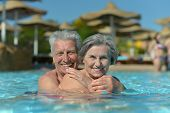 Elderly couple in pool