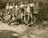 OSENBERGE, GERMANY, CIRCA FIFTIES - Vintage photo of group of children during a school trip