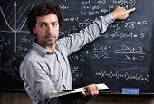 portrait of caucasian teacher and blackboard background