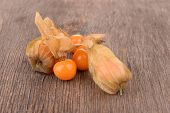 Physalis fruits on wooden background