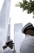 NEW YORK - MAY 23, 2014: Low angle view of US Navy officers with the Freedom Tower in the background