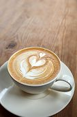 image of latte  - Close up Cup of latte coffee on wooden - JPG