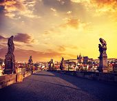 Vintage retro effect filtered hipster style travel image of Charles bridge and Prague castle in the