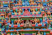 stock photo of tamil  - Sculptures on Hindu temple gopura  - JPG