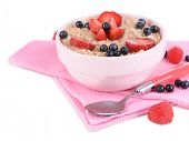 Tasty oatmeal with berries isolated on white