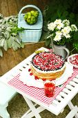 Tasty cake with fresh berries on table, close up