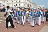 ST.LEONARDS-ON-SEA, ENGLAND - JUNE 12, 2014: Dende Nation, Samba drum troupe, perform during a parad