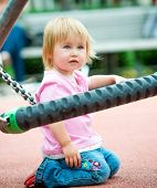Cute little girl is playing on playground