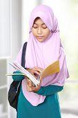 stock photo of muslim kids  - Muslim kid student reading something on book - JPG