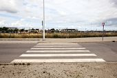 Pedestrian crossing in abandoned housing estate building site, Valencia region, Spain
