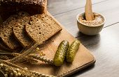Bread Lard And Pickles On Old Wooden Cutting Board
