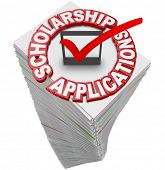 Scholarship Applications paperwork stack for you to fill out and apply for merit awards and financia