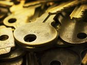 Many brass keys. Many brass keys extremely close up. Security and encryption, concept image. High magnification macro.