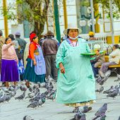 LA PAZ, BOLIVIA, MAY 9, 2014 - Local woman sells sweet desserts on Plaza Murillo
