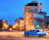 HAVANA,CUBA - JULY 9, 2014 : Urban scene at night in Old Havana with a view of a classic american ca