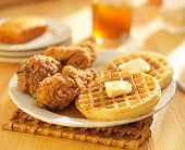 chicken and waffles with sweet tea in background