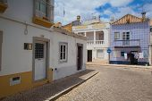 Typical Historic Street With Moorish Elements In Tavira City.