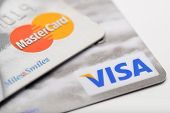 Ankara, Turkey - October 17, 2012 : Studio shot of two major credit cards Visa and MasterCard over w