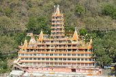 stock photo of shiva  - Tera Manzil Hindu Temple Trimbakeshwar dedicated to Shiva from the Lakshman Jhula bridge - JPG