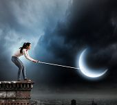 Young woman in casual holding moon on lace