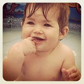 Baby girl playing in pool - With Instagram effect