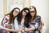 Women sleeping on sofa while wearing sunglasses