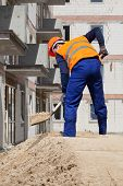 Builder Working Using Shovel