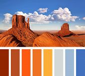 The iconic Mitten Butte rock formations of Monument Valley, in a colour palette with complimentary s