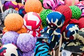 A pile of colorful fabric spheres