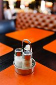 image of salt shaker  - pepper and salt shaker on table at restaurant - JPG