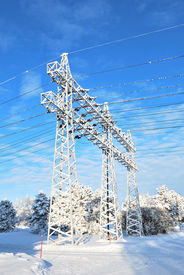 image of power lines  - Electricity pylons and transmission lines covered with rime in winter - JPG