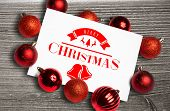 Christmas message against digitally generated grey wooden plank