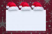 Santa hat on poster against snowflake wallpaper pattern