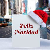 Feliz navidad against blurry new york street