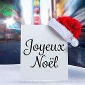 Joyeux noel against blurry new york street