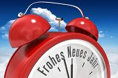 Frohes neues jahr in red alarm clock against bright blue sky with clouds