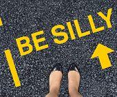 Businesswomans feet against black road