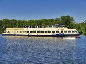 MOSCOW, RUSSIA - JULY 19, 2014: Pleasure boat with passengers on the river