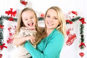 mother and baby having christmas fun