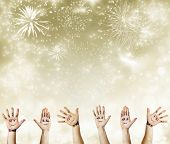 Painted hands with smiling faces celebrating New Year - New Year concept