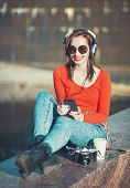Beautiful Hipster Girl In Sunglasses Listening Music