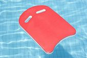 A Red Float Floating In Blue Pool