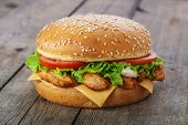 foto of hamburger  - hamburger with chicken and cheese on a wooden surface - JPG