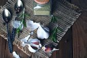 Raw garlic and spices on wooden table