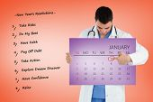Portrait of a young doctor pointing at a calendar against purple card