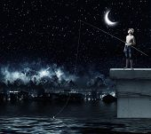 picture of boys night out  - Young boy at night with fishing rod - JPG