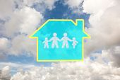 Cloud in shape of family against blue sky with white clouds