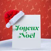 Joyeux noel against orange reindeer pattern