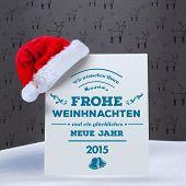 German christmas greeting against grey reindeer pattern