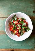 stock photo of flax seed oil  - Tomato and arugula salad with flax seeds - JPG